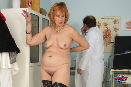 Redhead Kvetuse Poses with Close-fitting Black Nylons and Hirsute Pussy